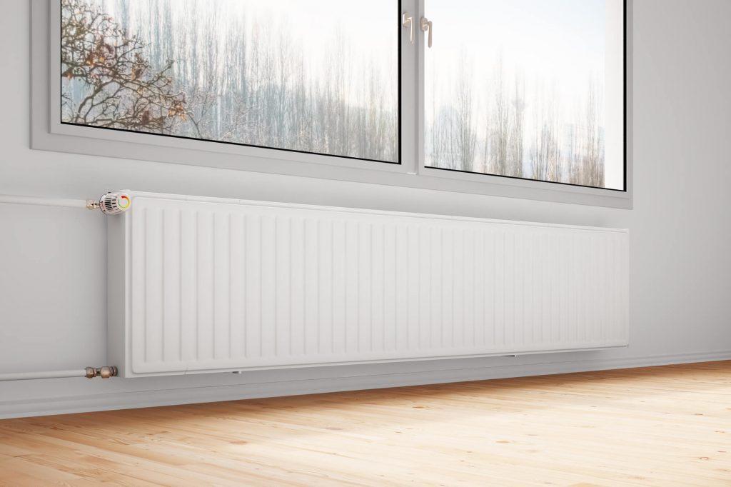 a white radiator under the window